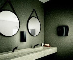 plan vasque avec robinets et sèche-mains noirs
